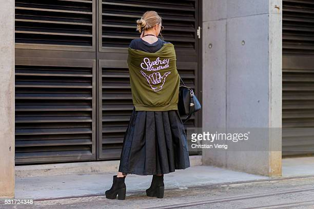 A guest wearing a Sydney sweater outside Yeojin Bae at MercedesBenz Fashion Week Resort 17 Collections at Carriageworks on May 16 2016 in Sydney...