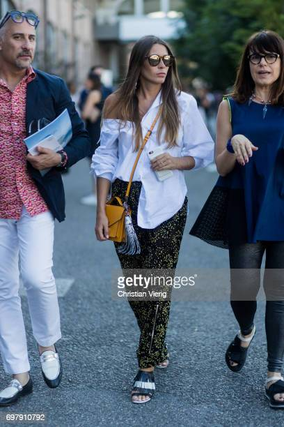 A guest wearing a white button shirt green black pants is seen outside Malibu 1992 during Milan Men's Fashion Week Spring/Summer 2018 on June 19 2017...
