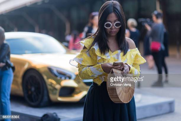 A guest wearing a yellow off shoulder top at day 2 during MercedesBenz Fashion Week Resort 18 Collections at Carriageworks on May 15 2017 in Sydney...