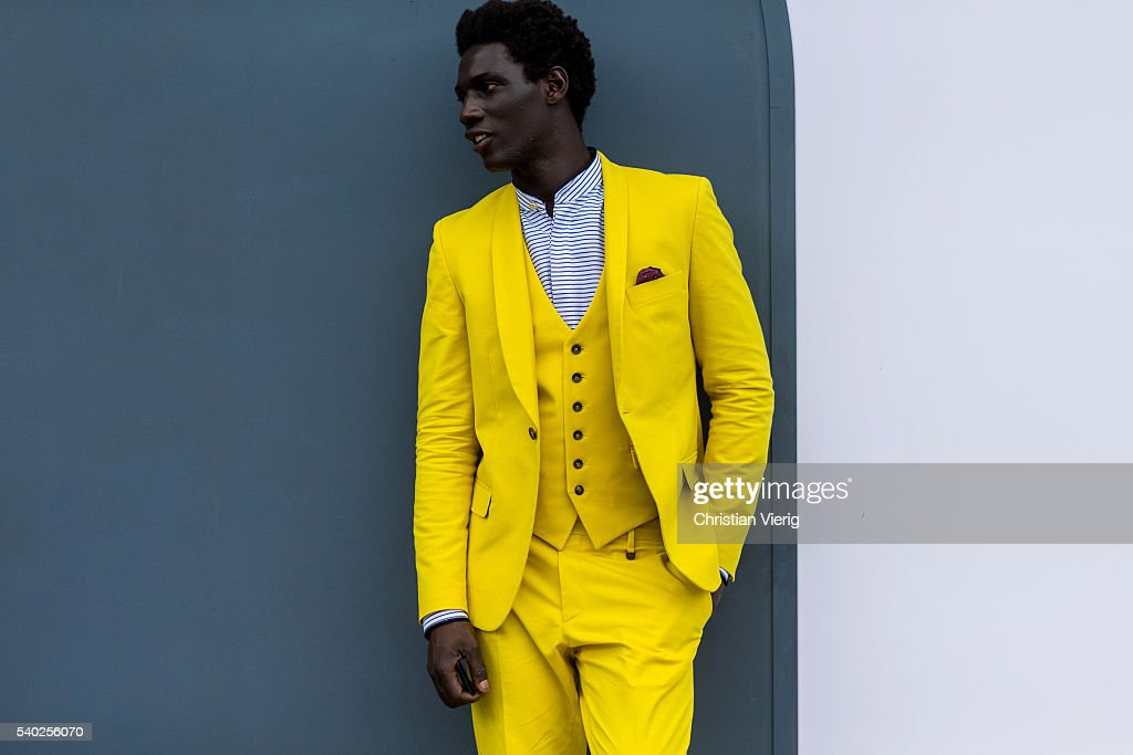 A guest wearing a yellow suit and vest during Pitti Uomo 90 on June 14, 2016, in Florence, Italy