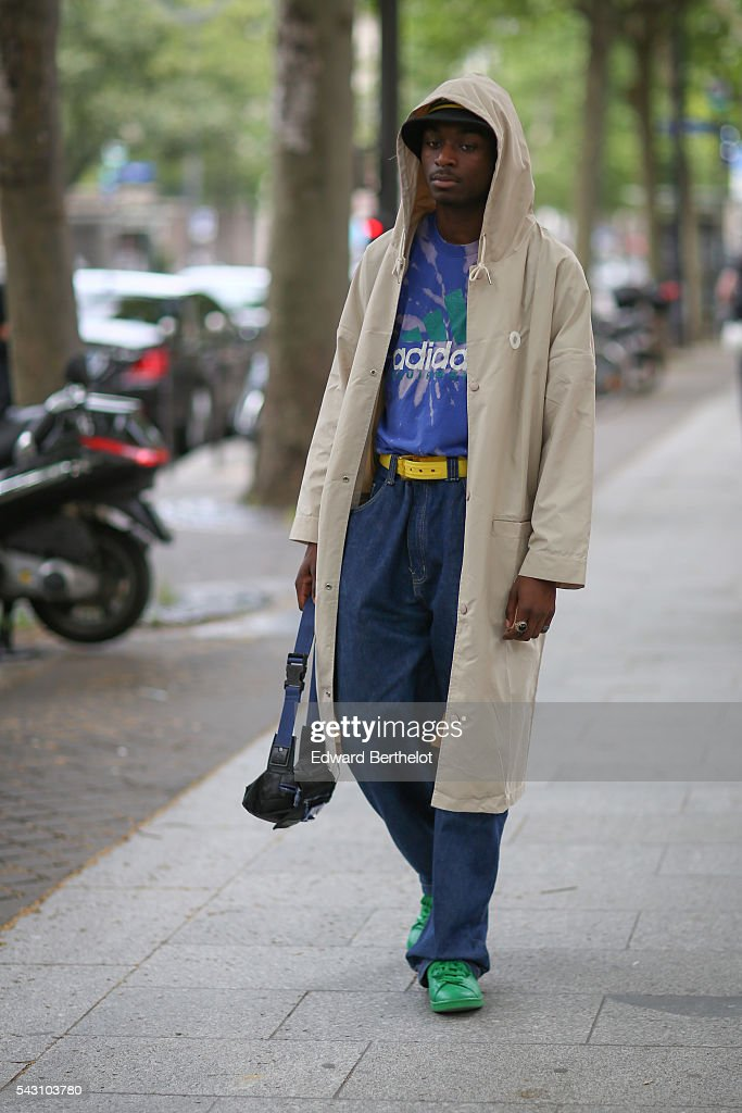 A guest wearing an Adidas top, and green shoes, is seen, after the Balmain show, during Paris Fashion Week Menswear Spring/Summer 2017, on June 25, 2016 in Paris, France.