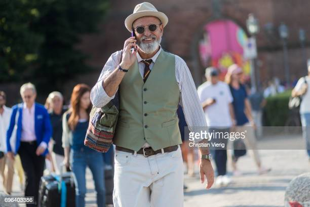 A guest wearing an olive vest is seen during Pitti Immagine Uomo 92 at Fortezza Da Basso on June 15 2017 in Florence Italy