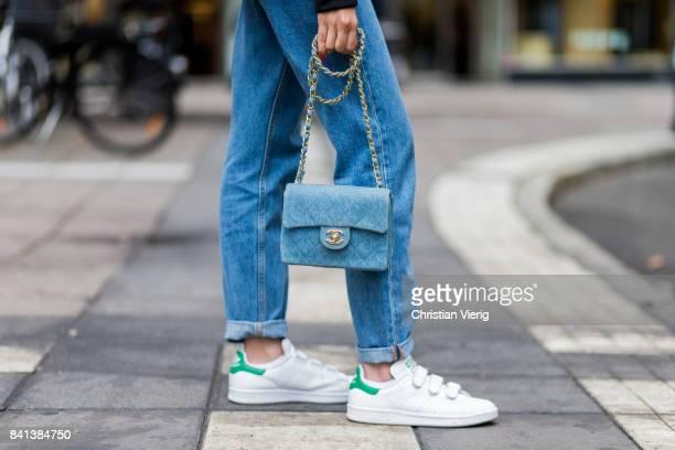 A guest wearing baby blue Chanel bag denim jeans on August 31 2017 in Stockholm Sweden