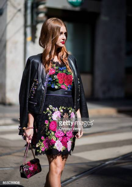 A guest wearing bag dress leather jacket and shoes Dolce Gabbana is seen outside Dolce Gabbana during Milan Fashion Week Spring/Summer 2018 on...