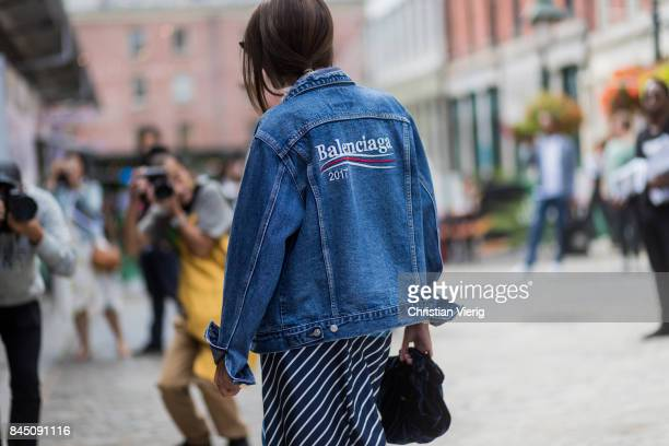 A guest wearing Balenciaga denim jeans jacket seen in the streets of Manhattan outside Tibi during New York Fashion Week on September 9 2017 in New...