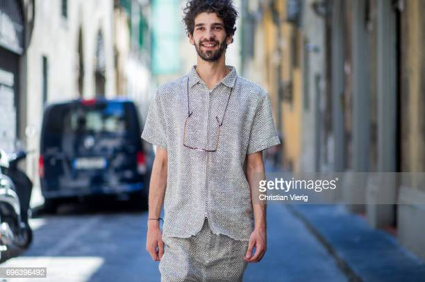 A guest wearing beige shirt and cropped pants is seen during Pitti Immagine Uomo 92 at Fortezza Da Basso on June 15 2017 in Florence Italy