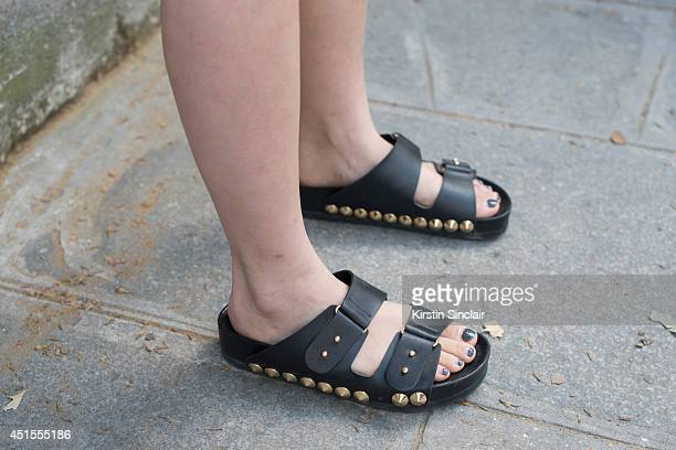 A guest wearing Birkenstock shoes on day 1 of Paris Collections Men on June 25 2014 in Paris France