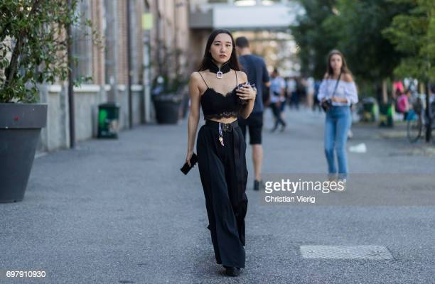 A guest wearing black top choker high waisted pants is seen outside Malibu 1992 during Milan Men's Fashion Week Spring/Summer 2018 on June 19 2017 in...
