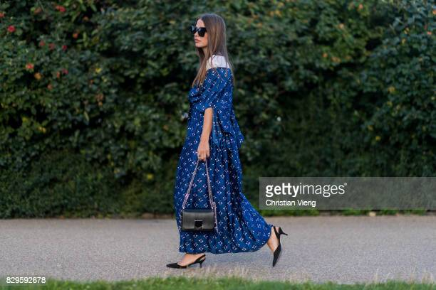A guest wearing blue dress Jimmy Choo bag outside Saks Potts on August 10 2017 in Copenhagen Denmark