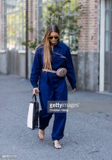 A guest wearing blue jumpsuit is seen outside Malibu 1992 during Milan Men's Fashion Week Spring/Summer 2018 on June 19 2017 in Milan Italy