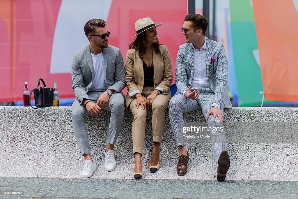 A guest wearing Chanel shoes and a beige suit and hat and a guest wearing a grey plaid suit during Pitti Uomo 90 on June 14, 2016, in Florence, Italy