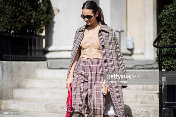 A guest wearing checked pants checked blazer outside Pringle of Scotland during London Fashion Week September 2017 on September 18 2017 in London...