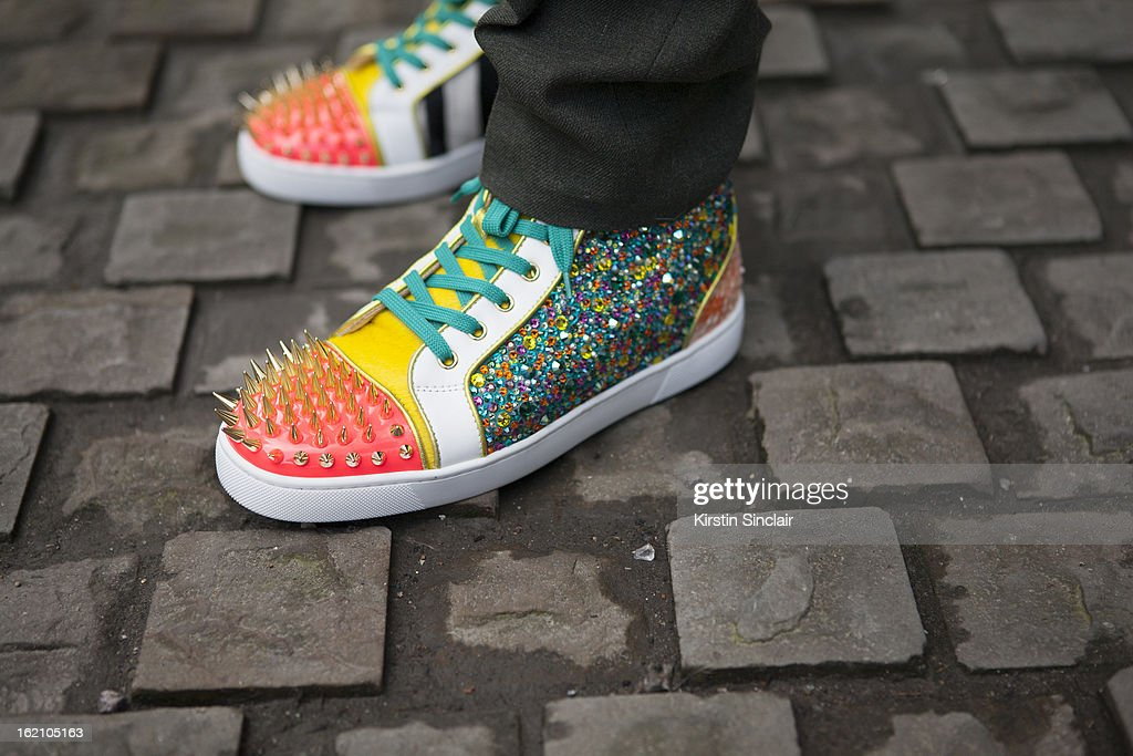 A guest wearing Christian Louboutin shoes on day 4 of London Womens Fashion Week Autumn/Winter 2013 on February 18, 2013 in London, England.