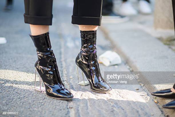 A guest wearing Dior boots after Dior during the Paris Fashion Week Womenswear Spring/Summer 2016 on October 2 2015 in Paris France