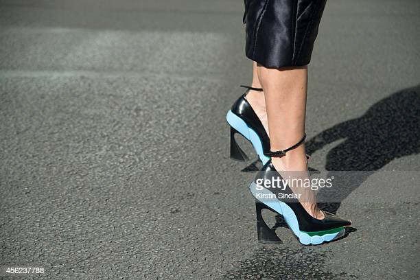 Guest wearing Dior shoes on day 4 of Paris Collections Women on September 26 2014 in Paris France