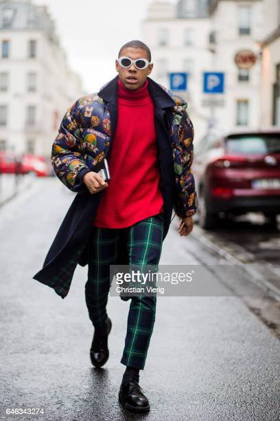 A guest wearing down feather jacket red tutleneck sweater checked pants outside AALTO on February 28 2017 in Paris France