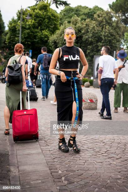 Guest wearing Fila tshirt and Ikea belt is seen during Pitti Immagine Uomo 92 at Fortezza Da Basso on June 15 2017 in Florence Italy