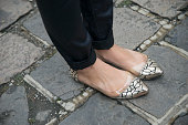 A guest wearing flat gold shoes day 5 of Paris Haute Couture Fashion Week Autumn/Winter 2014 on July 10 2014 in Paris France