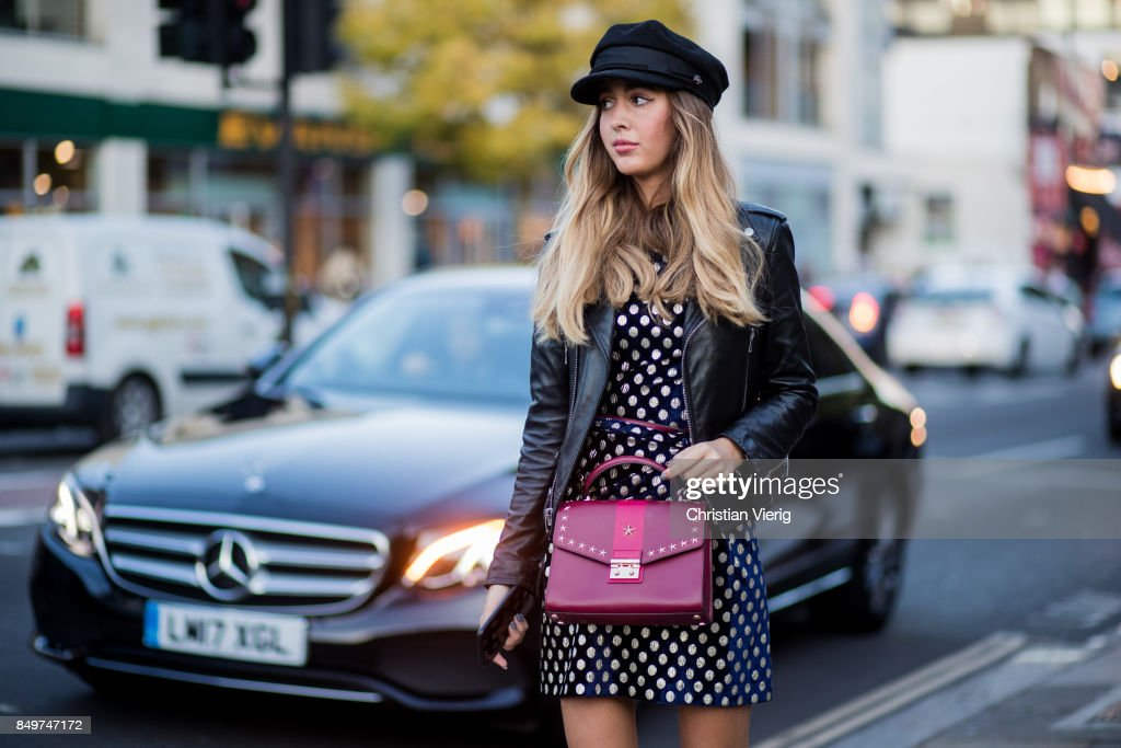 A guest wearing leather jacket, dress, flat cap outside Tommy Hilfiger during London Fashion Week September 2017 on September 19, 2017 in London, England.