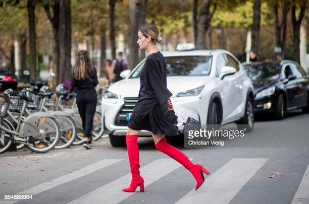A guest wearing overknees is seen outside Rochas during Paris Fashion Week Spring/Summer 2018 on September 27 2017 in Paris France