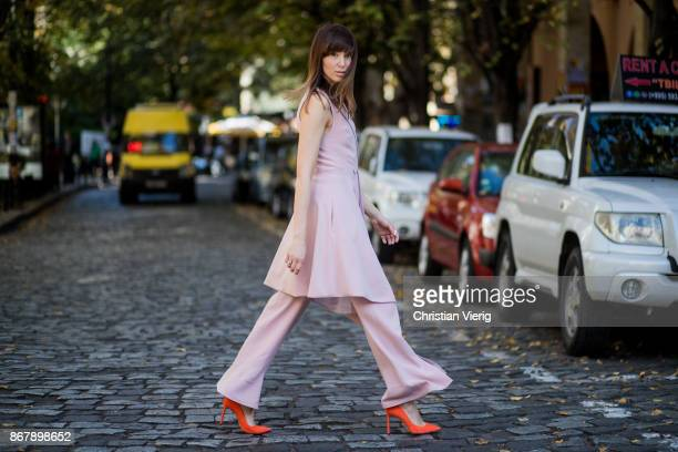 A guest wearing pink pants sleeveless top and orange heels is seen during Tbilisi Fashion Week Spring/Summer 2018 on October 29 2017 in Tbilisi...