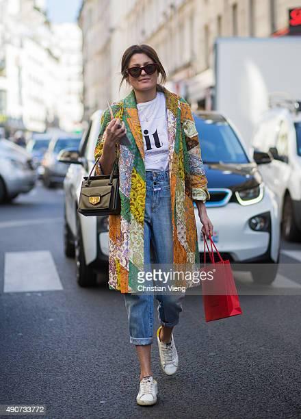 A guest wearing Prada during Paris Fashion Week Womenswear Spring/Summer 2016 on September 30 2015 in Paris France