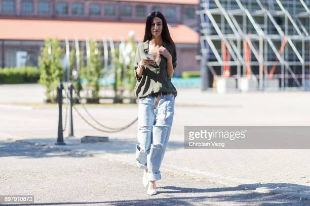 A guest wearing ripped denim jeans is seen outside Malibu 1992 during Milan Men's Fashion Week Spring/Summer 2018 on June 19 2017 in Milan Italy