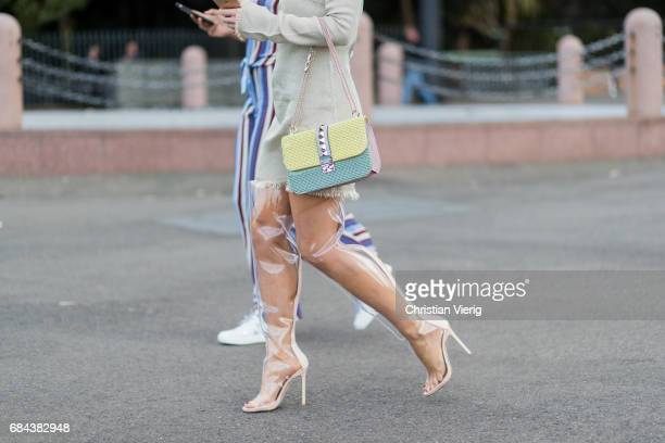 A guest wearing sheer overknees and Valentino bag outside Dyspnea at day 5 during MercedesBenz Fashion Week Resort 18 Collections at Sydney Opera...