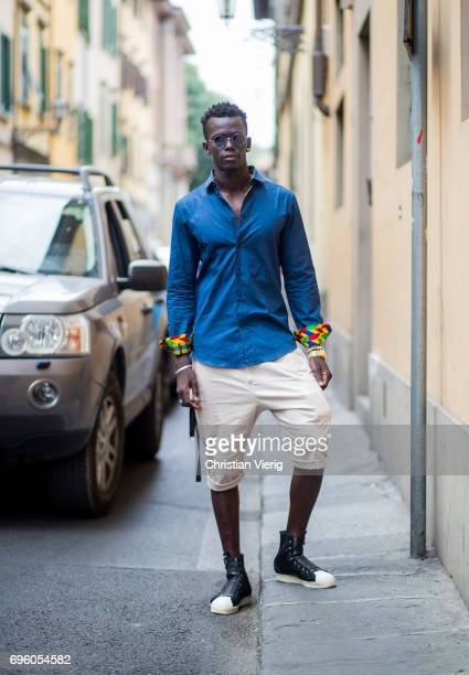A guest wearing shorts blue button shirt is seen during Pitti Immagine Uomo 92 at Fortezza Da Basso on June 14 2017 in Florence Italy