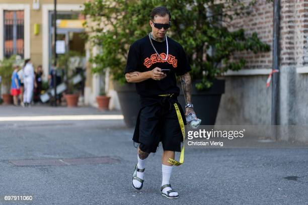 A guest wearing shorts sandals white sneaker is seen outside Malibu 1992 during Milan Men's Fashion Week Spring/Summer 2018 on June 19 2017 in Milan...