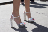 A guest wearing silver crystal heeled shoes day 3 of Paris Haute Couture Fashion Week Autumn/Winter 2014 on July 8 2014 in Paris France