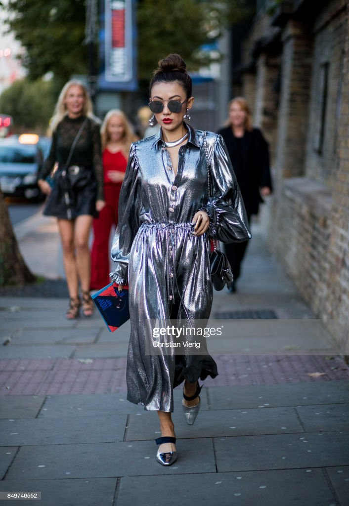 A guest wearing silver dress outside Tommy Hilfiger during London Fashion Week September 2017 on September 19, 2017 in London, England.