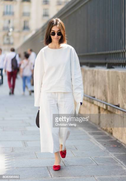 A guest wearing white knit white pants outside Ulyana Sergeenko during Paris Fashion Week Haute Couture Fall/Winter 20172018 Day Three on July 4 2017...