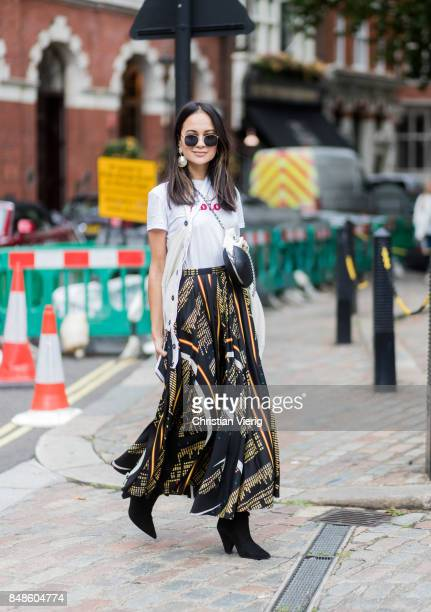 A guest wearing white tshirt and skirt outside Preen during London Fashion Week September 2017 on September 17 2017 in London England