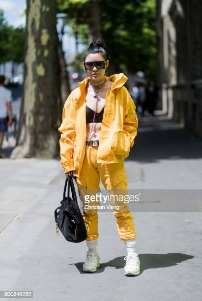 A guest wearing yellow zip hoody cropped top yellow pants outside Y3 during Paris Fashion Week Menswear Spring/Summer 2018 Day Five on June 25 2017...