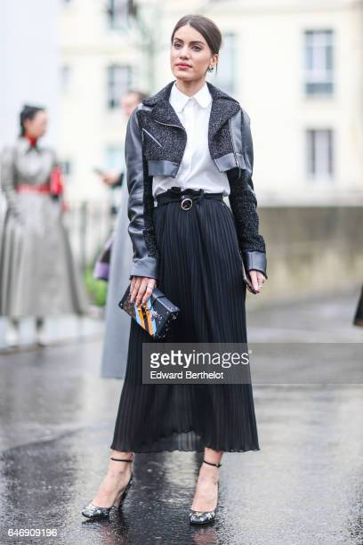 A guest wears a a jacket a white top and a black skirt outside the Rochas show during Paris Fashion Week Womenswear Fall/Winter 2017/2018 on March 1...