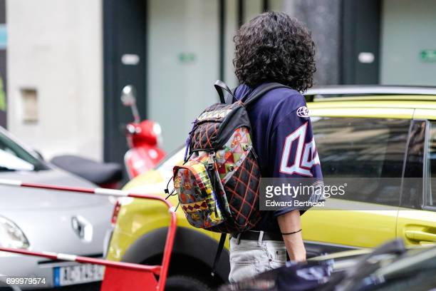 A guest wears a backpack with embroidered features outside the OAMC show during Paris Fashion Week Menswear Spring/Summer 2018 on June 21 2017 in...
