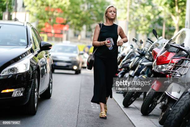 A guest wears a black dress outside the OAMC show during Paris Fashion Week Menswear Spring/Summer 2018 on June 21 2017 in Paris France