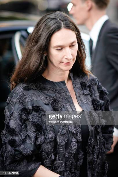 A guest wears a black outfit with embroidery outside the Vogue foundation dinner during Paris Fashion Week Haute Couture Fall Winter 2017/2018 on...