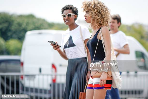 A guest wears a black tank top a brown bag outside the Icosae show during Paris Fashion Week Menswear Spring/Summer 2018 on June 21 2017 in Paris...