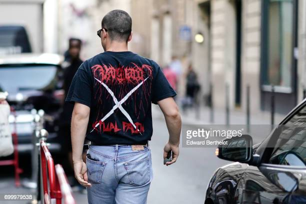 A guest wears a black tshirt with a printed cross outside the OAMC show during Paris Fashion Week Menswear Spring/Summer 2018 on June 21 2017 in...