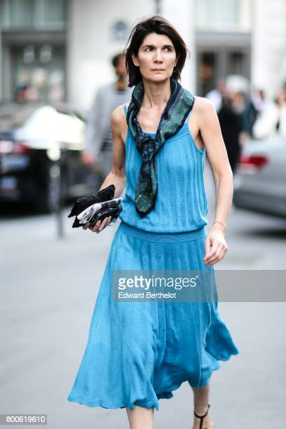 A guest wears a blue ruffled dress outside the Hermes show during Paris Fashion Week Menswear Spring/Summer 2018 on June 24 2017 in Paris France