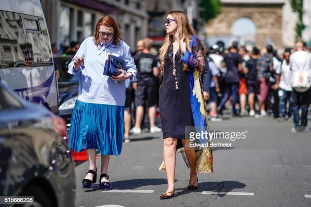 A guest wears a blue shirt a blue bag a blue ruffle skirt black sandals a guest wears sunglasses a blue dress outside the Jean Paul Gaultier show...