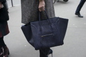 A guest wears a Celine bag day 2 of Paris Haute Couture Fashion Week Spring/Summer 2014 on January 21 2014 in Paris France