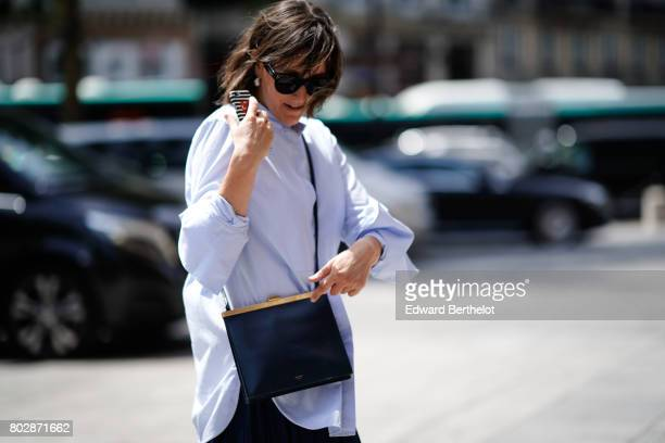 A guest wears a Celine bag outside the Louis Vuitton show during Paris Fashion Week Menswear Spring/Summer 2018 on June 22 2017 in Paris France