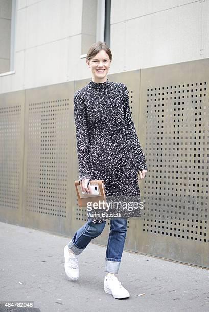 A guest wears a Celine dress before Bottega Veneta show on February 28 2015 in Milan Italy