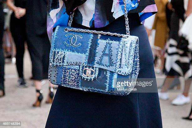 Guest wears a Chanel bag at MercedesBenz Fashion Week Australia 2015 at Carriageworks on April 14 2015 in Sydney Australia