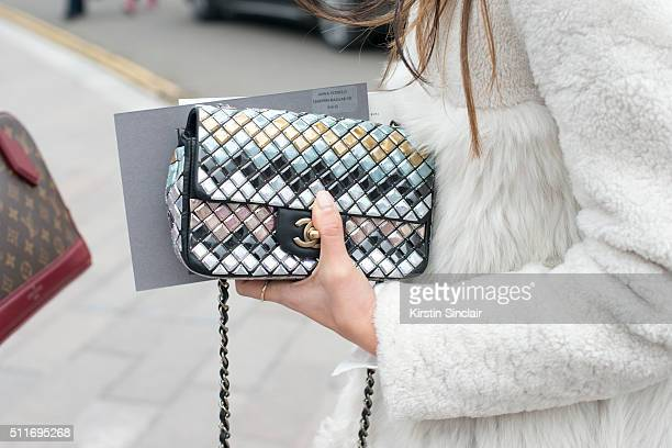 A guest wears a Chanel bag on day 3 during London Fashion Week Autumn/Winter 2016/17 on February 21 2016 in London England