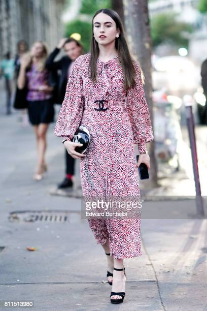 A guest wears a Chanel red dress outside the launch party for Chanel's new perfume 'Gabrielle' during Paris Fashion Week Haute Couture Fall/Winter...