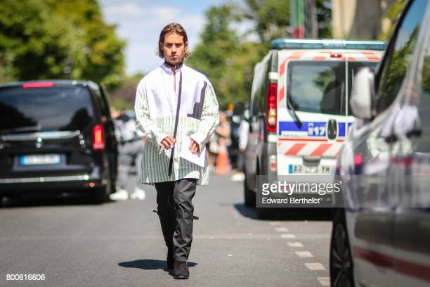A guest wears a choker a striped jacket black pants outside the Dior show during Paris Fashion Week Menswear Spring/Summer 2018 on June 24 2017 in...